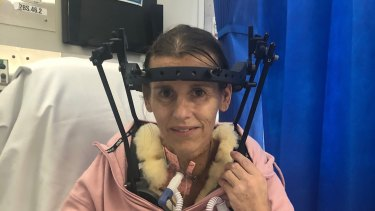 Keri Frecklington several weeks after the surgery with her head brace and tracheotomy tube.