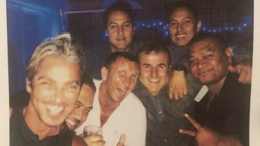 John Ibrahim (left) partying with former strip club manager Michael Amante (white shirt).