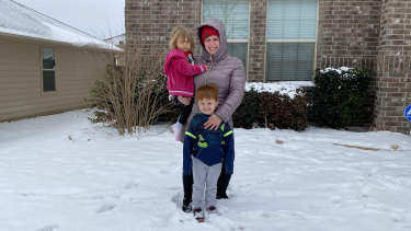 Rebekah Sawyer with children Wyatt and Emma outside their home in Fort Worth, Texas.