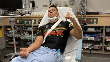 Scott Sorensen in his game-worn jersey after waiting almost 24 hours to have his dislocated wrist put back in place.