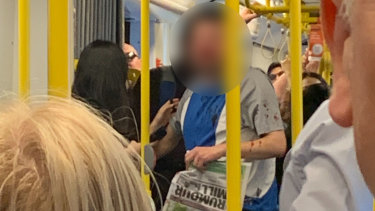 The victim with blood spattered on his shirt after a vicious assault on the 96 tram on Bourke Street.