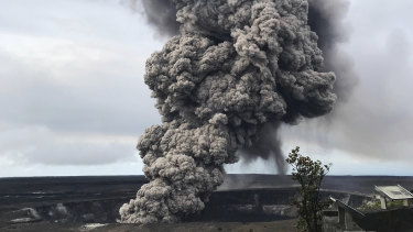 An ash column rises from the crater at the summit of Kilauea volcano on Wednesday.