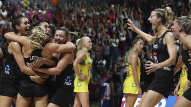 New Zealand players celebrate after winning the Netball World Cup final.