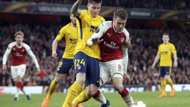 Tussle: Atletico's José Giménez and Arsenal's Aaron Ramsey battle for possession.