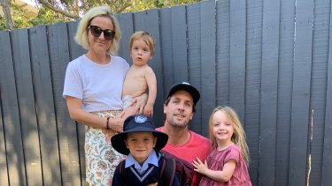 Erin Hughes in happier times with her husband Trevor and their three children.