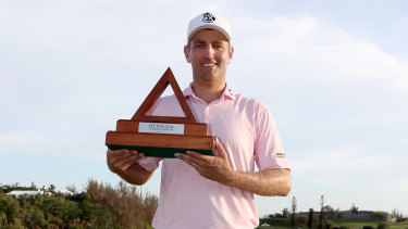 Brendon Todd celebrates with the Bermuda Championship trophy.