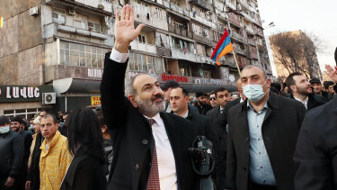 Armenian Prime Minister Nikol Pashinyan waves to supporters during a rally.