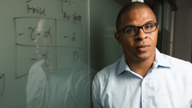 Economist Roland Fryer has been placed on administrative leave for two years.