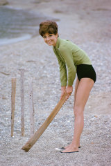 Audrey Hepburn plays cricket on the beach during a break from filming Stanley Donen's Two for the Road in 1966.