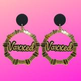 """Custom """"Vaxxed"""" earrings from Sydney jewellery brand Haus of Dizzy."""