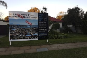 An example of the type of signage now on homes for sale within the redevelopment zone.