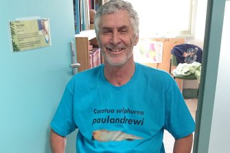Paul Andrew with a T-shirt bearing the name of the bird named after him.