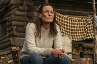 Home on the range: Edee (Robin Wright) on the porch of her mountainside cabin retreat in Land.