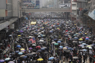 Protesters march in Hong Kong on Sunday.