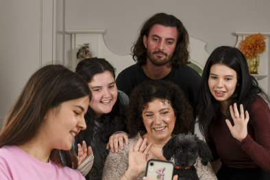 Nicole Cullinan, her four children, from left to right,Sophie 19, Faith 16, Tom, 21, Bella 23 years old and dog Frankie at their Melbourne home. Nicole and her husband Mark , a surgeon,  have made the difficult decision for Mark to move out of home during the Coronavirus pandemic to protect the family.