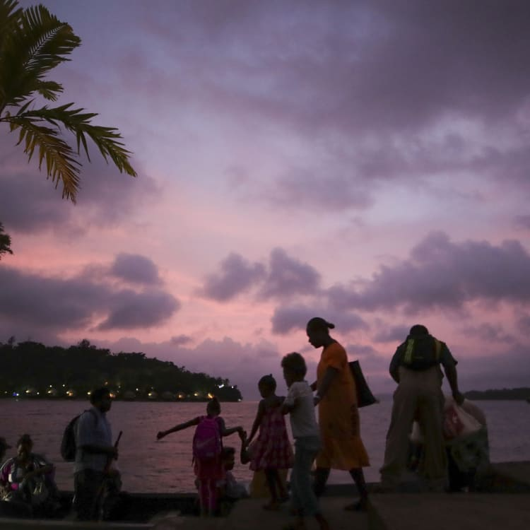 Locals head home at the end of the day on Vila Bay.