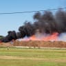 Caravans destroyed and mulch machine on fire as crews battle blazes
