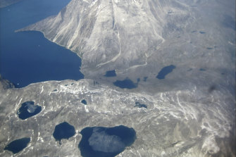 An aerial view of melt-water lakes on the edge of an ice cap in Nunatarssuk, Greenland, taken on June 22.