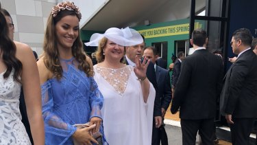 Gina Rinehart gives the royal wave inside the Birdcage at this year's Melbourne Cup.