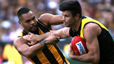 Trent Cotchin fended off Jarman Impey when the Tigers and the Hawks met earlier this season.