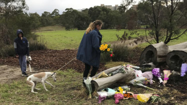 Annette Graham, 48, and 11-year-old son Coulton brought a bouquet of yellow roses to Royal Park to pay tribute to Courtney Herron on Monday morning.