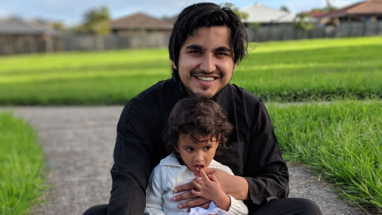 Fahim Khondaker at the park with Liyana, the second of his three daughters.