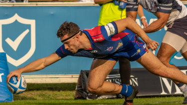 Try time: Alex Northam crosses for Manly.