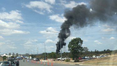 Thick smoke billows over Rocklea markets after rubbish ignites
