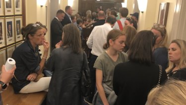 Residents wait in the corridors of the council building.