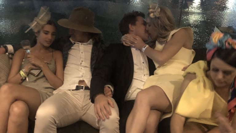 Nick Cummins and his manager/cousin Josh White getting touchy feely at the Melbourne Cup after, after party.
