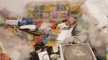 A supplied image of part of the $1.56 million dollars in cash seized by police during a house raid in New Farm on Monday.