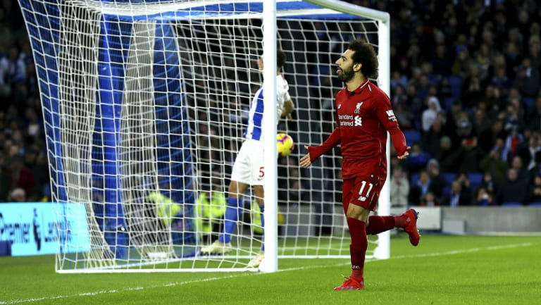 Spot on: Mohamed Salah celebrates after converting the only goal in Liverpool's victory.