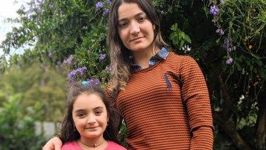 Yazidi refugee Nihad Barakat al-Awsi with her niece at their home in Toowoomba.
