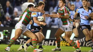 Matt Moylan is still feeling the effects of this hit from South Sydney's Sam Burgess.