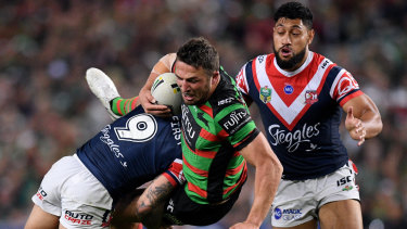 Committed: Sam Burgess is driven back by the Roosters' busy rake Jake Friend.