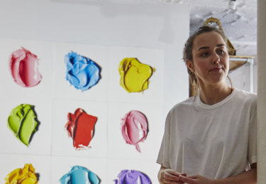 Cj Hendry in front of her hand-drawn work in Brooklyn, New York.