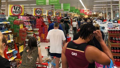 Panic buying creates 'traffic congestion, crowd issues' at Queensland shops