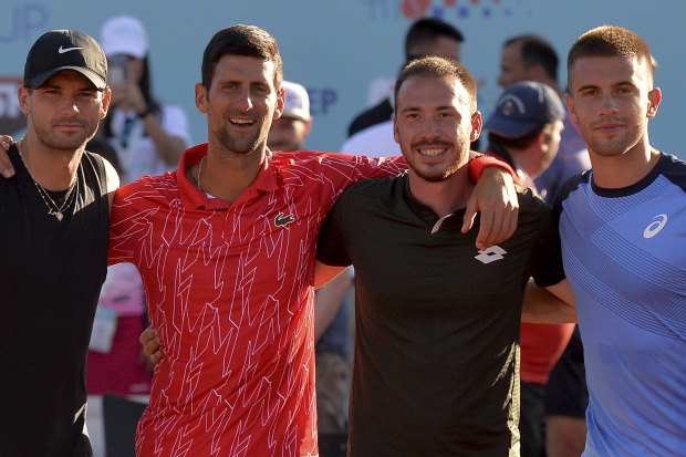 Novak Djokovic, second from left, poses with Bulgaria's Grigor Dimitrov (left), Serbia's Viktor Troicki and Croatia's Borna Coric in Croatia. All have tested positive to COVID-19.