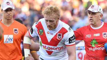James Graham leaves the field after suffering a head knock in 2018.