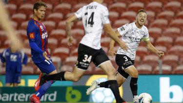 Scott Jamieson of Melbourne City puts a pass through to Connor Metcalfe.
