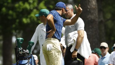 Jason Day holds his back on the fourth tee at Augusta.