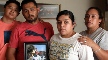 The Maldonado family, Benjamin Maldonado, Sr., second from left, and his wife Adriana Garcia right, with children Benjamine Maldonado, Jr, left, and Xitlali Raya Garcia, second from right at their San Lorenzo, California home, with a portrait of their son Jovani, 15, who was killed when a Tesla operating on autopilot rear-ended the family's pickup truck. The family is suing Tesla, claiming its Autopilot system was partly responsible.