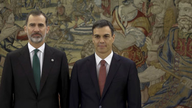 Spain's King Felipe VI, left, with Spain's new Prime Minister Pedro Sanchez, who was sworn in at the Zarzuela Palace in Madrid, on Saturday.