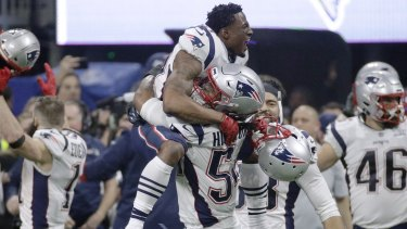 Not long after celebrating their win, many New England Patriots players, including Dont'a Hightower (centre), said they would skip a White House visit.