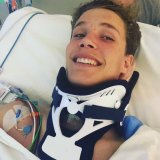 Alex Noble, from St Ignatius College, Riverview, after he was injured in 2018.