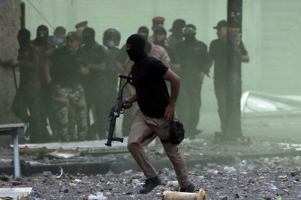 Iraq security forces use their weapons to disperse protesters.