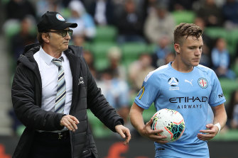 Melbourne City coach Erick Mombaerts, left, speaks to Scott Galloway.