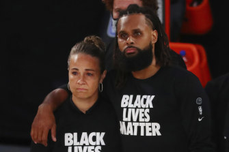 Patty Mills, right, and San Antonio assistant coach Becky Hammon before San Antonio's return NBA win over Sacramento.
