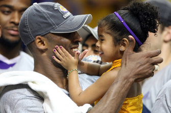 Kobe Bryant celebrates with his daughter Gianna following the Lakers' NBA victory in 2009.
