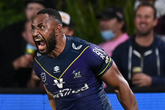 Justin Olam celebrates his 76th-minute try for the preliminary-final bound Storm on Friday night.